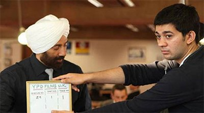 sunny deol and son karan deol during shooting