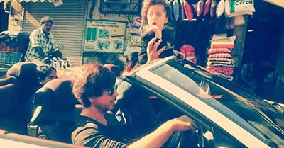 shah rukh khan going for a drive with his son