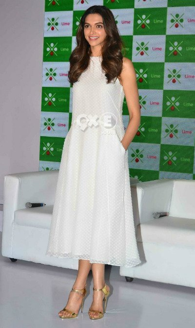 deepika padukone in white dress and golden sandals