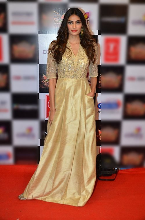 athiya shetty in golden dress at an musical event