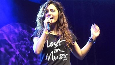 neeti mohan singing at an concert