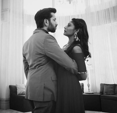 the lead couple of ishqbaaz in a romantic still