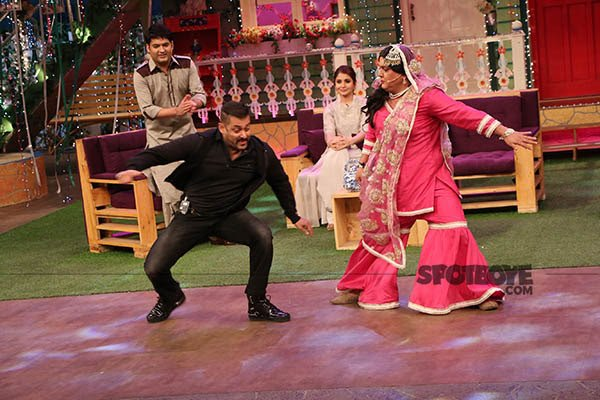 salman khan with ali asgar on the sets of the kapil sharma show during sultan promotion