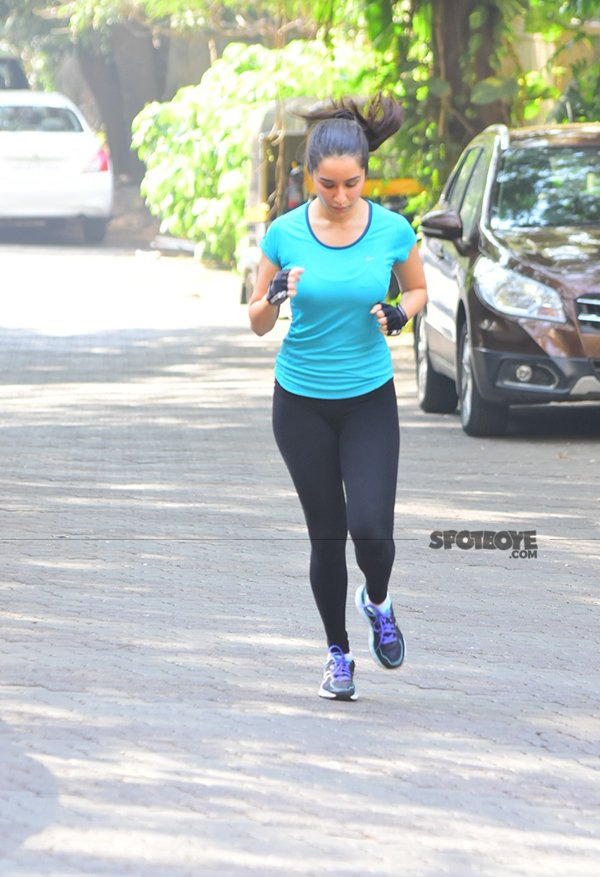 dressed in a blue t shirt and black jeggings shraddha is acing her fitness goals