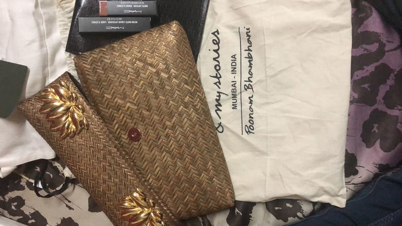 Brown Clutch With Two Lipsticks