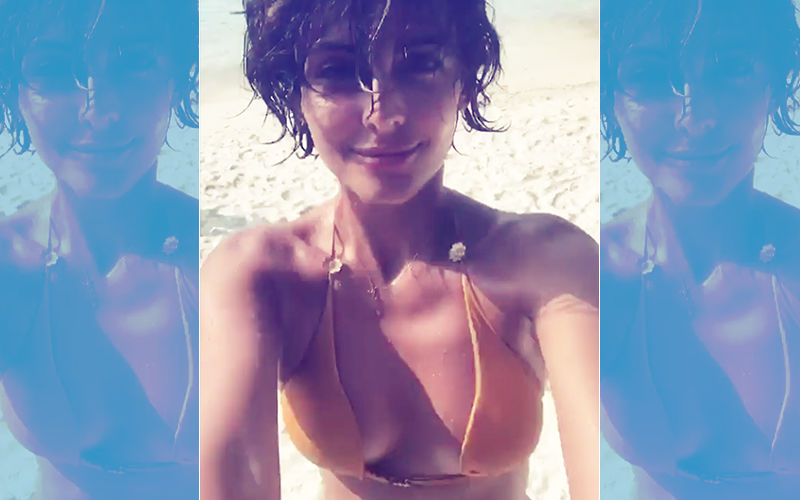 Summer Gets Hotter! Mandana Karimi Sports A Yellow Bikini In Cool Blue Waters