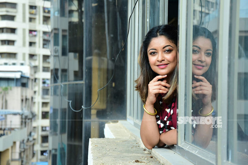Tanushree dutta looks out of the window while flaunting her million dollar smile