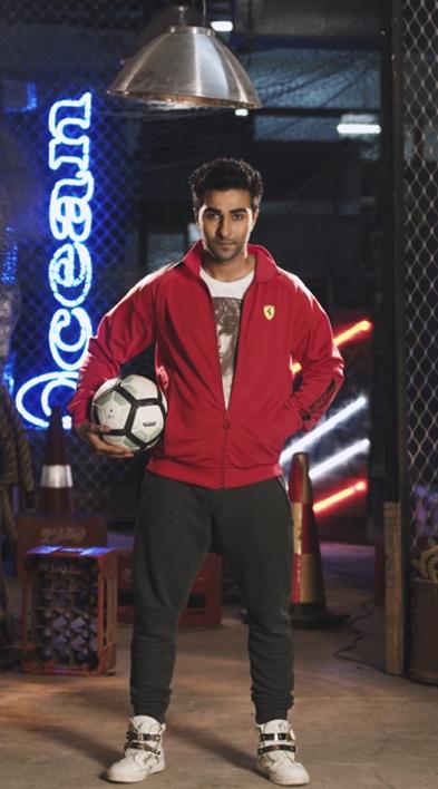 aadar jain posing with a football