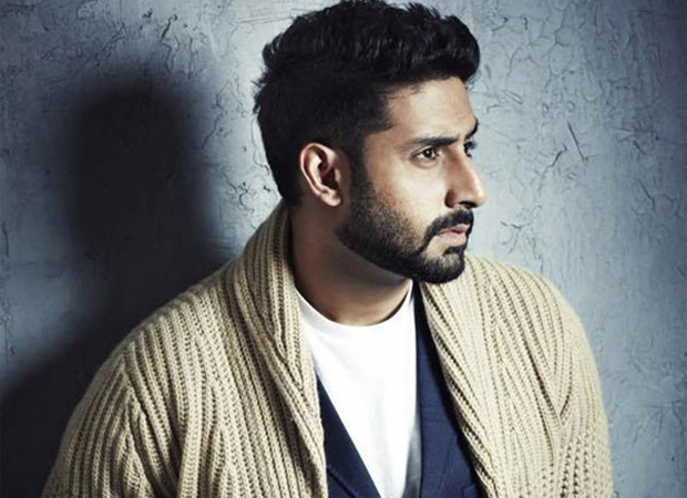 abhishek bachchan poses for a photo shoot