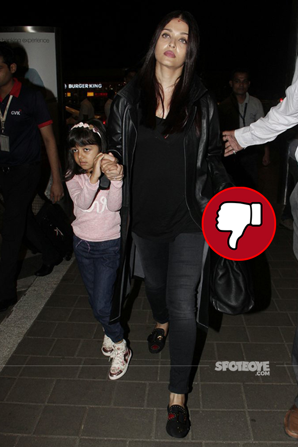 aishwarya rai bachchan snapped at the mumbai airport in a black overcoat