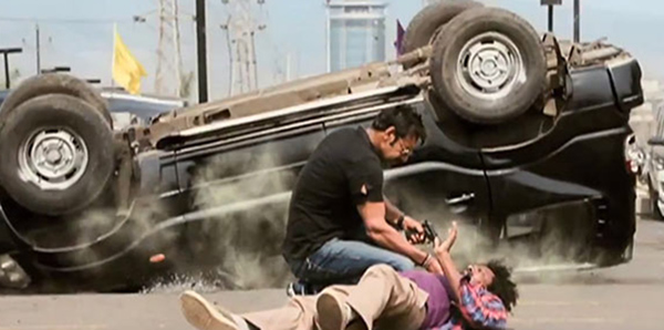ajay devgn in an action scene from rohit shetty singham