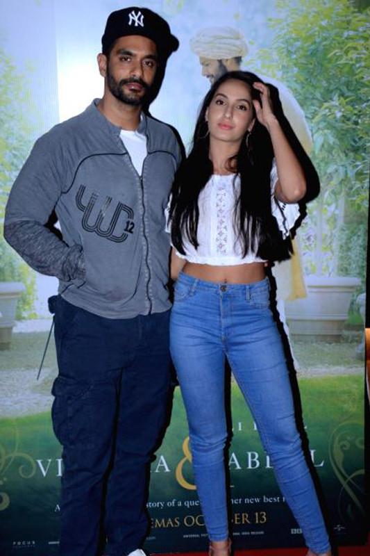 angad bedi with nora fatehi