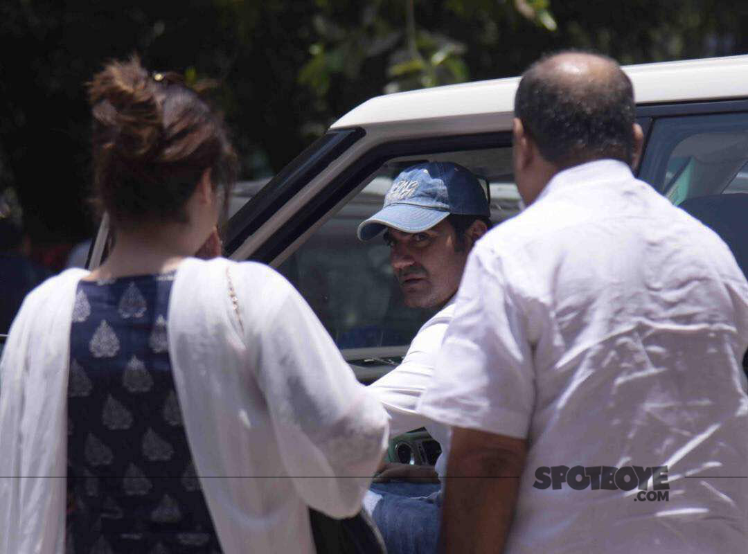 arbaaz khan sitting in car is about to leave the session court