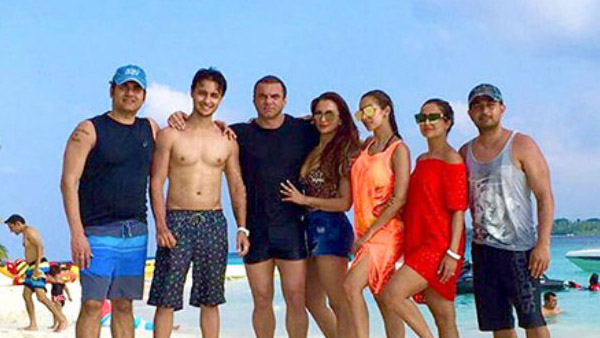 arbaaz khan with his family on a vacation