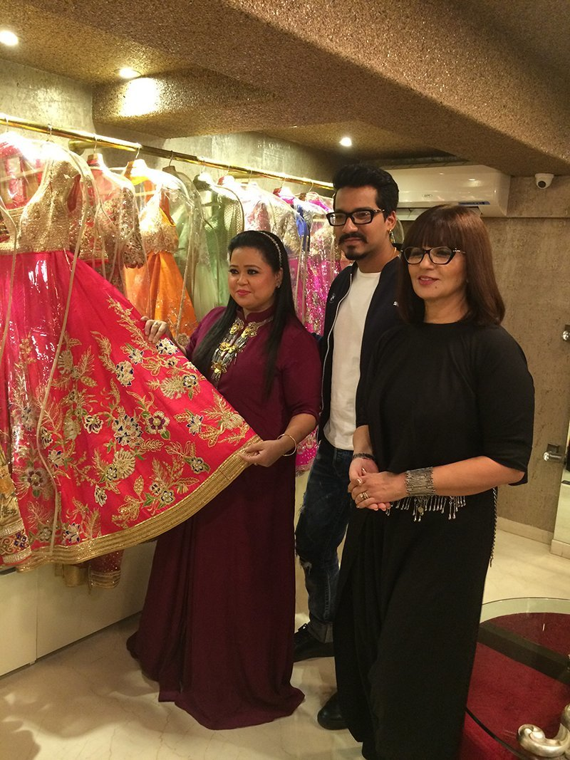 bharti singh and haarsh limbachiyaa checking out a lehenga