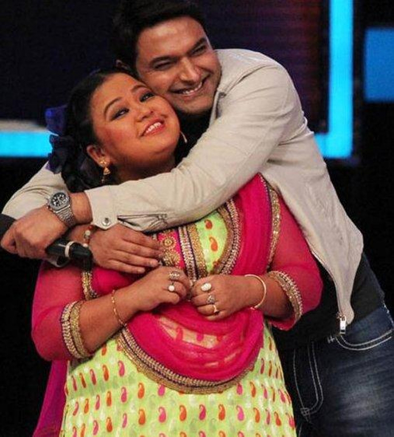 bharti singh and kapil sharma pose for a photoshoot