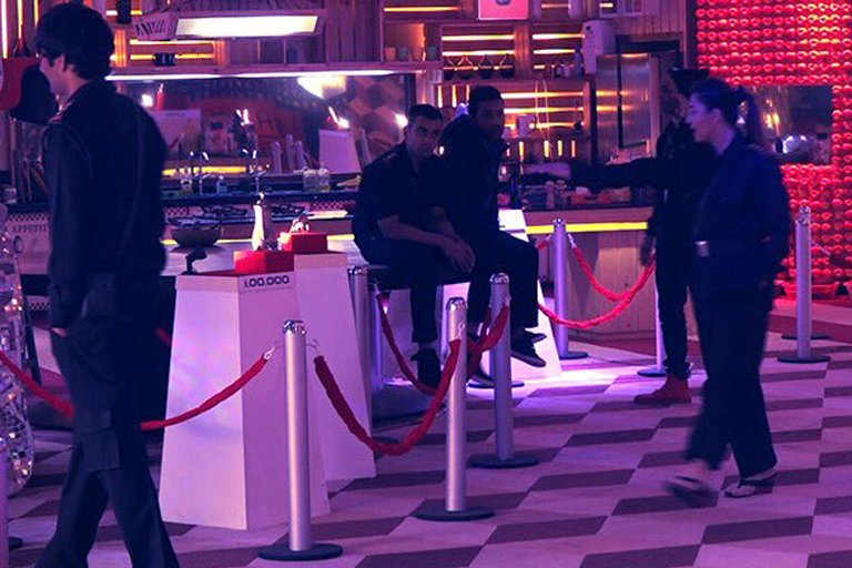 bigg boss contestants performing a task