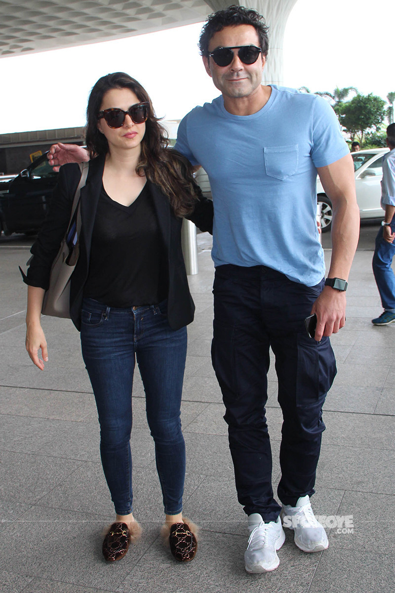 bobby deol snapped with wife at the airport