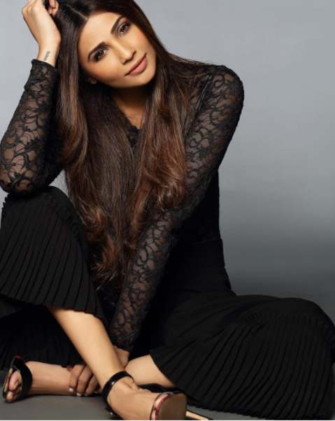daisy shah poses for a photo shoot