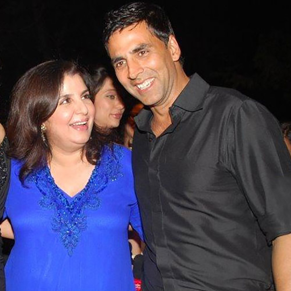 farah khan and akshay kumar are all smiles as they pose for the cameras