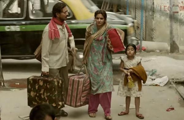 irrfan khan and saba qamar along with their onscreen daughter in a still from hindi medium