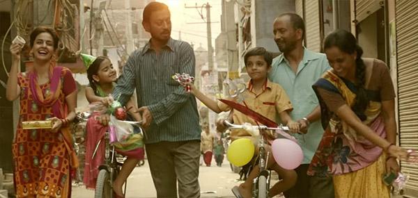 irrfan khan, saba qamar, deepak dobriyal and rest of the cast enjoying za moment in a still from hindi medium