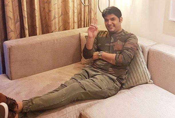 kapil sharma poses for a photo shoot