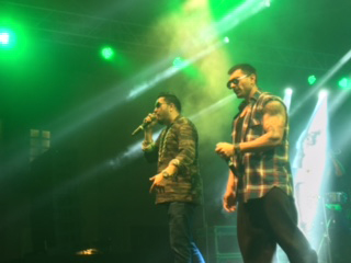 karan singh grover with mika singh on stage singing