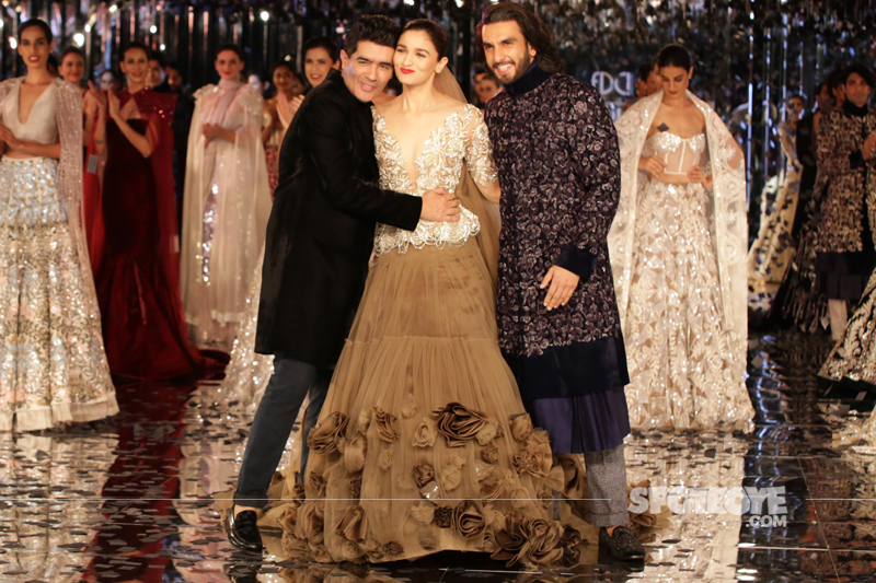 manish malhotra hugs alia bhatt ranveer singh poses for the paps