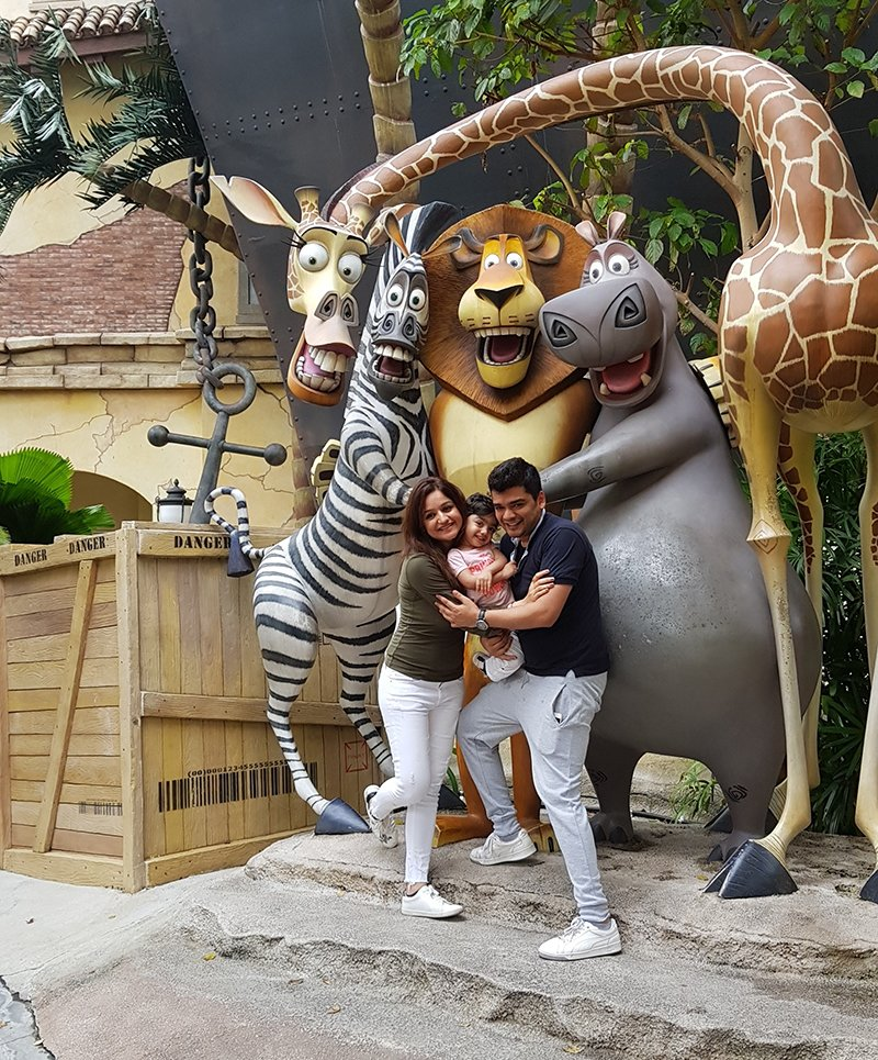 muskaan mihani tushal sobhani with their daughter mannat at the universal studios in singapore