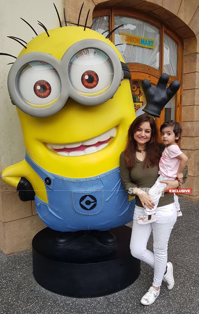 muskaan poses beside a minion with daughter mannat