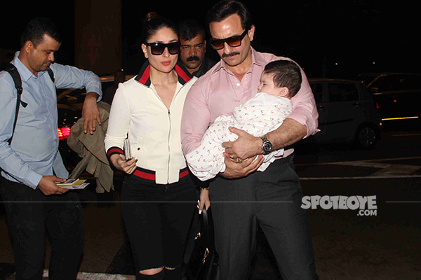 pataudi family saif ali khan and kareena kapoor pose with taimur  ali at the airport