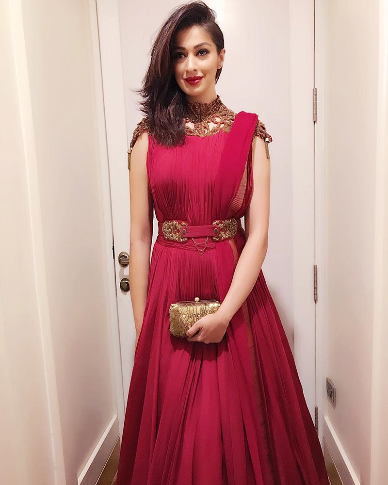 raai laxmi in a red gown