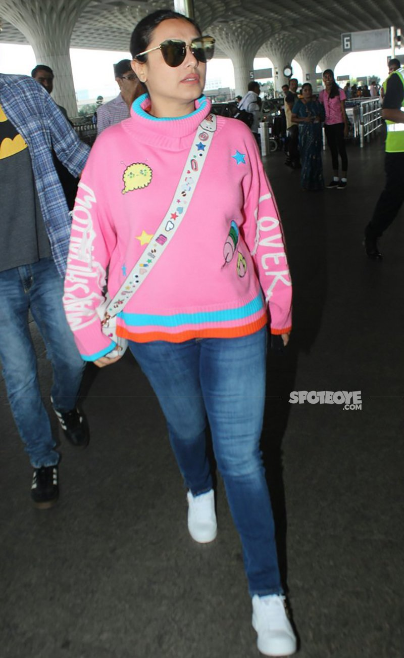 rani mukerji in a pink outfit at the airport
