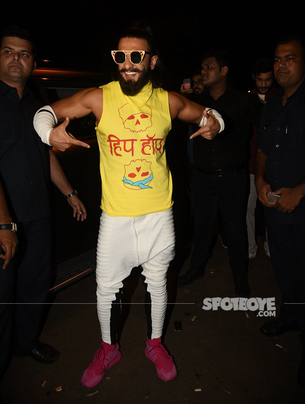 ranveer singh poses for the photogs at a  lounge