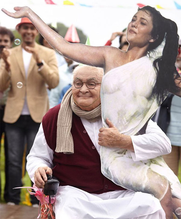rishi poosing with a cutout of mandakini in a still from kapoor and sons