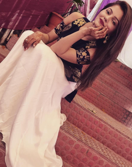 rubina dilaik poses for a photoshoot