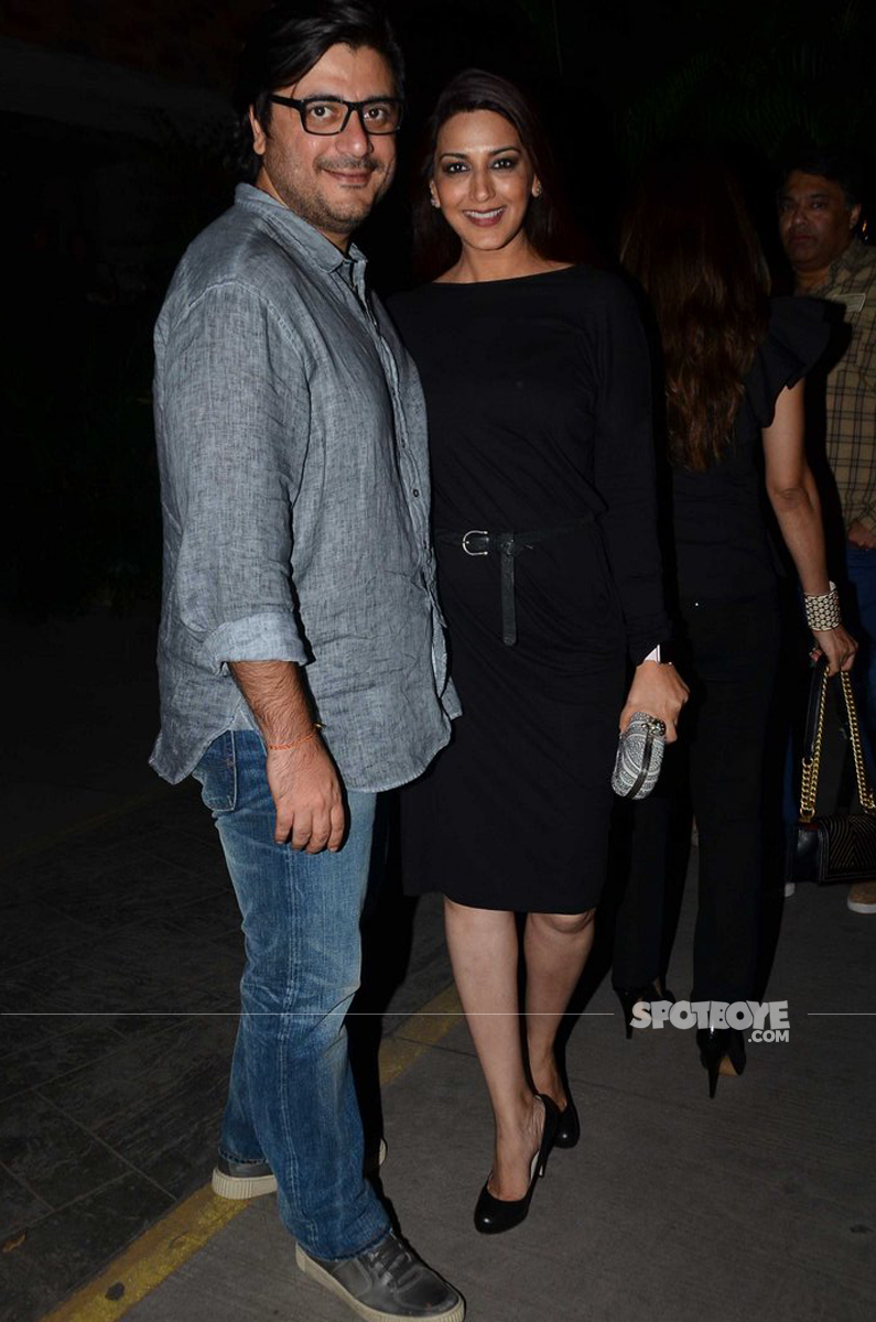 sonali bendre and her husband pose for shutterbugs