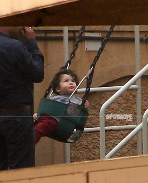 taimur ali khan is all smiles as he rides on the swing