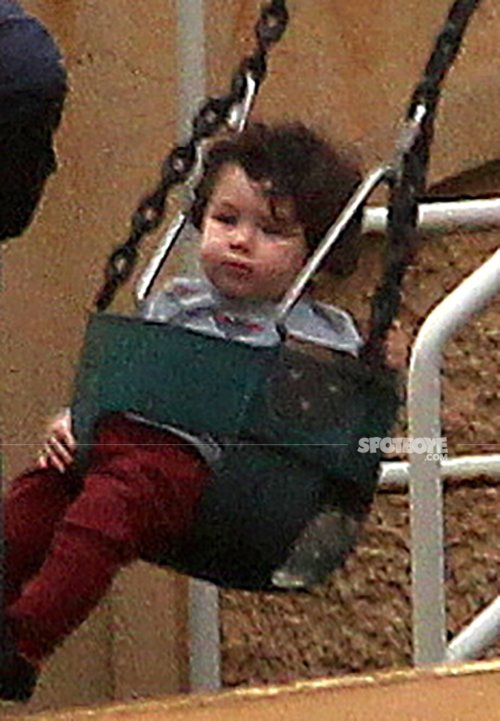 taimur ali khan plays with the house helps as he tries to wriggle out of the swing