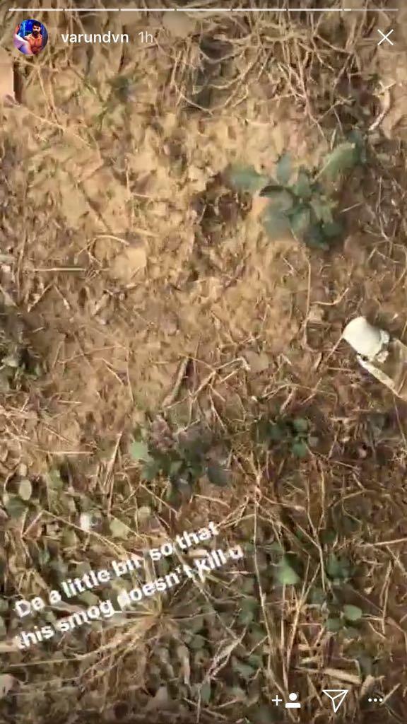 varun dhawan picking up the waste