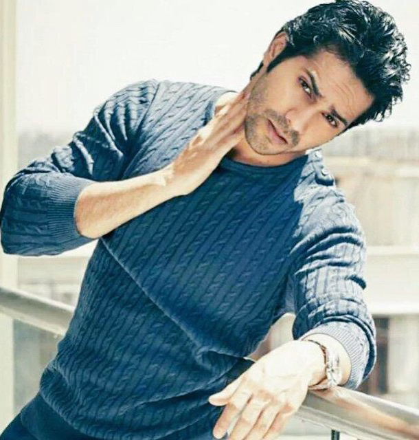 varun dhawan poses for a photoshoot