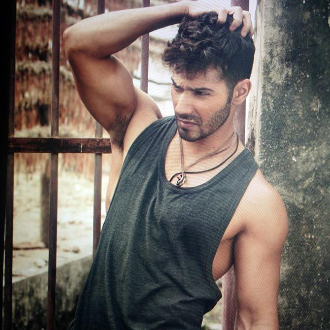 varun dhawan posing for a photoshoot