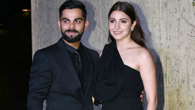virat kohli and anushka sharma pose for shutterbugs