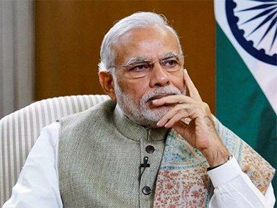 pm narendra modi engrossed