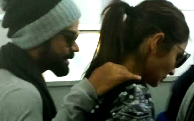 Protective Boyfriend Virat Keeps An Arm Around Anushka As They Leave Dehradun