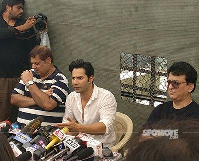 varun and david dhawan at a press meet