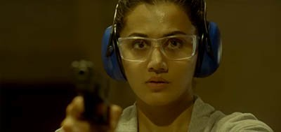 taapsee pannu with a gun while training to be a spy in a still from naam shabana