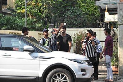 Sushant Singh Rajput with fan.jpg