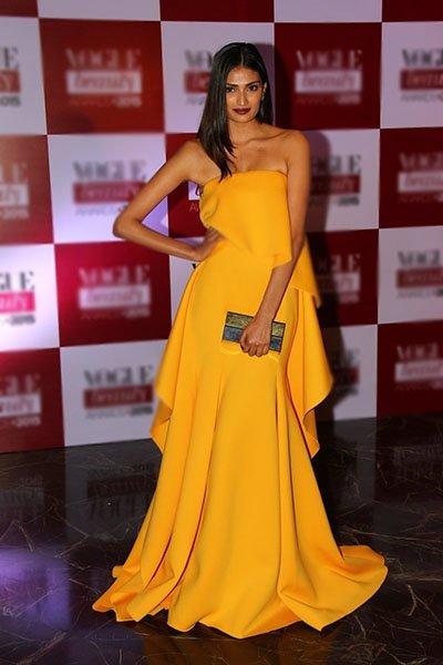 athiya shetty s first red carpe in a bright yellow gauri and nainika